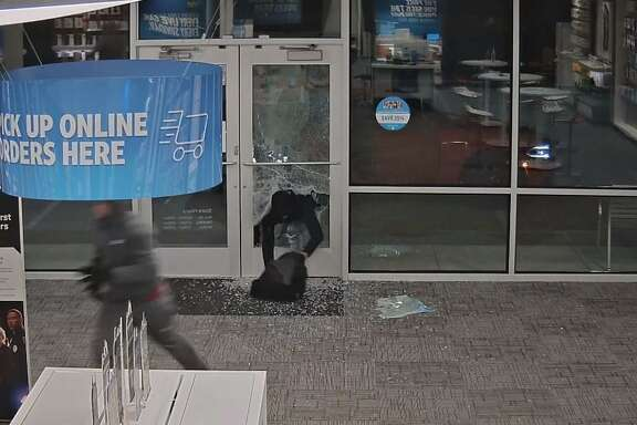 Video footage shows suspects breaking in to an AT& store in Cypress on Thursday, Nov. 29.