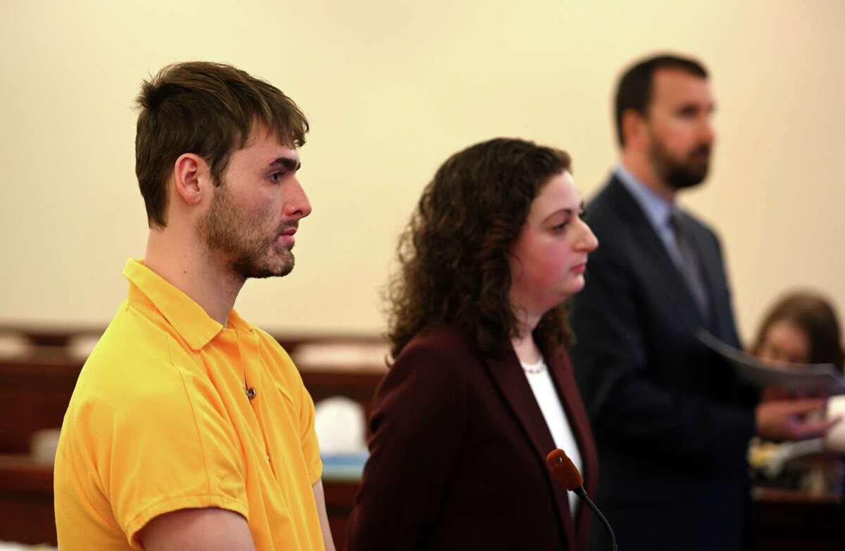 Thomas Slivienski, left, was arraigned in front of Judge Peter Lynch for the alleged murder of John Dunia in Cohoes Friday Nov. 30, 2018 at the Albany County Judicial Center in Albany, N.Y. Representing Slivienski was Rebekah Sokol, center and handling the case for the Albany County District Attorney is David Rossi, Chief Assistant DA., Right. (Skip Dickstein/Times Union)