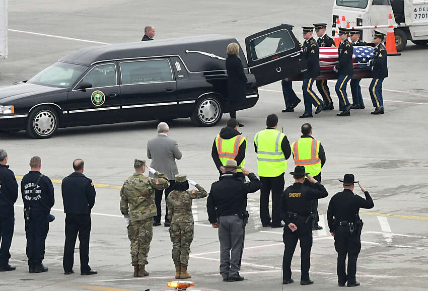 The remains of Pfc. John Martin, who vanished in North Korea in late 1950, are removed from a Delta airplane and placed in a hearse at the Albany International Airport on Friday, Nov. 30, 2018 in Colonie, N.Y. On Sunday, the 68th anniversary of his disappearance and likely combat death during the Korea War, he will be buried next to his mother and father after a funeral in Schuylerville. (Lori Van Buren/Times Union)