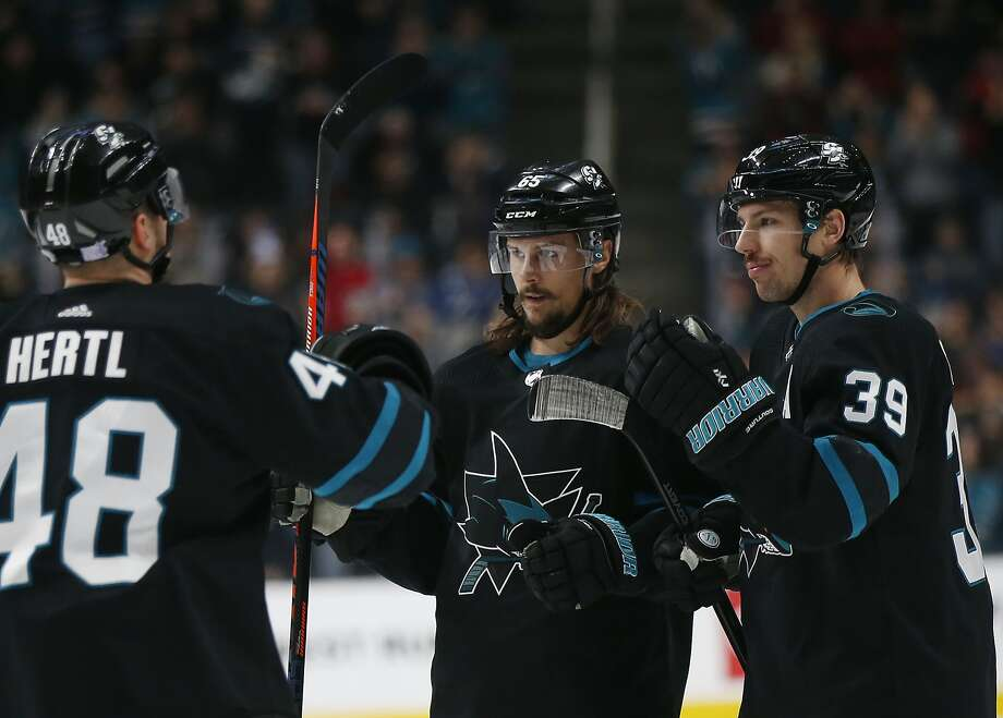 San Jose Sharks' Tomas Hertl (48) and Erik Karlsson (65) celebrate with Logan Couture (39), who scored a goal against the Vancouver Canucks during the first period of NHL hockey game in San Jose, Calif., Friday, Nov. 23, 2018. (AP Photo/Josie Lepe) Photo: Josie Lepe / Associated Press