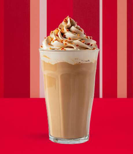 Gingerbread latte: Topped with a gingerbread whipped cream and crunchy wafer, sweet and spicy gingerbread flavors mingle with espresso and steamed milk. It is finished with a touch of ground nutmeg. Photo: Starbucks