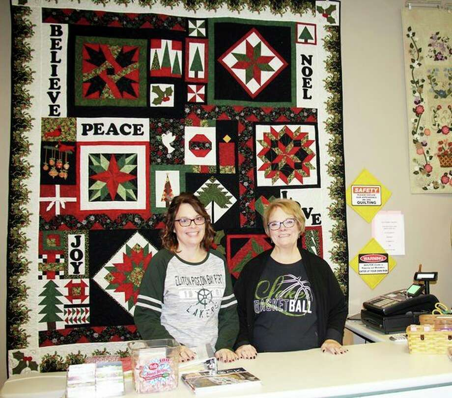 Daughter-mother duo(from left)Beckie Binder and Barbie Brooks have been in business together for 12 years. Brooks will be retiring and the two will be closing Backstreet Quilt Shop on Dec. 21. (Seth Stapleton/Huron Daily Tribune)