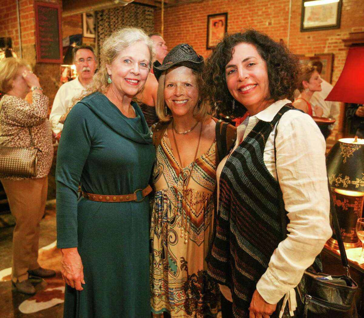 From the left, Nancy Parsons, Bonnie Longnion and Jenny Wright are pictured during the Bach, Beethoven and Barbecue Gala on Saturday, March 10, 2018, outside of Martin's Hall in downtown Conroe.