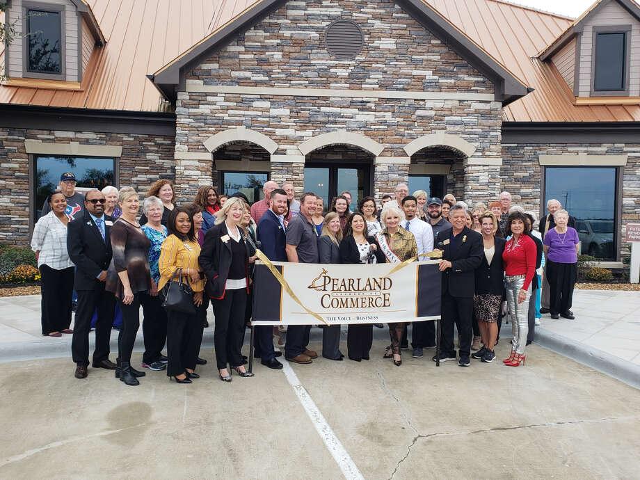 The Pearland Chamber of Commerce, Attiva residents, Attiva Pearland staff and Ms. Senior TX USA cut the ribbon on Attiva Pearland Thursday. Photo: Attiva