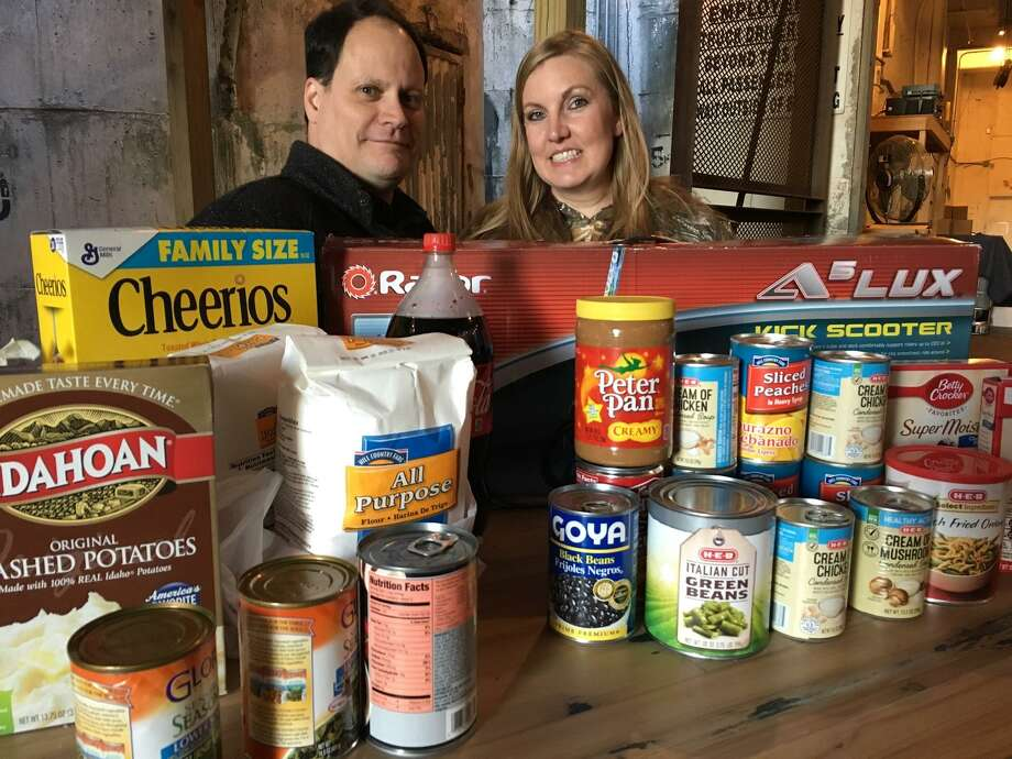 Nicholas and Nici Jessett, owners of MKT Distillery conducted a food drive in November to benefit Katy Christian Ministries. They said they plan to conduct a toy drive in December. Photo: Karen Zurawski / Karen Zurawski