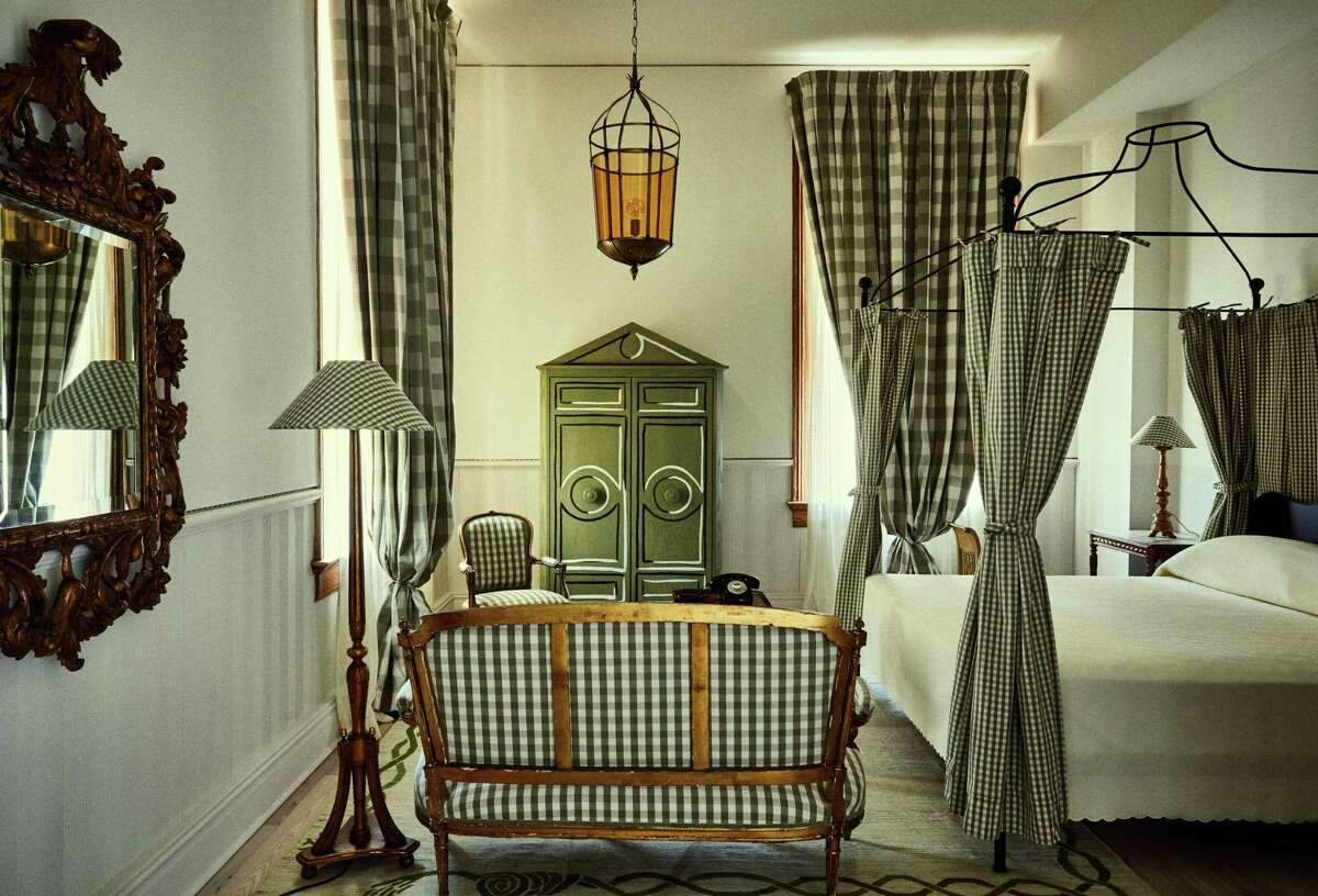 A gingham-clad guest room in the Schoolhouse at Hotel Peter & Paul