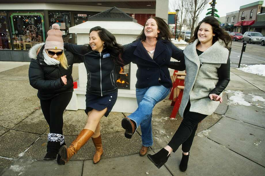 From left, Katie Guyer, Lucy Pagán, Jenni Bush and Cathleen Louisignau dance during the first #lunchbeat gathering on Friday, Nov. 30, 2018 in front of Pizza Sam's. (Katy Kildee/kkildee@mdn.net) Photo: (Katy Kildee/kkildee@mdn.net)