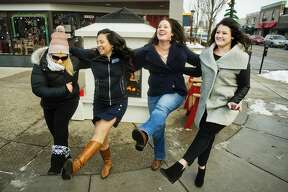 From left, Katie Guyer, Lucy Pagán, Jenni Bush and Cathleen Louisignau dance during the first #lunchbeat gathering on Friday, Nov. 30, 2018 in front of Pizza Sam's. (Katy Kildee/kkildee@mdn.net)