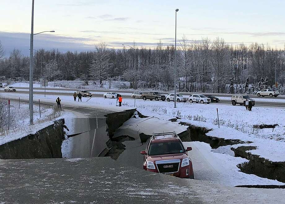 A car is trapped on a collapsed section of the offramp of Minnesota Drive in Anchorage, Friday, Nov. 30, 2018. Back-to-back earthquakes measuring 7.0 and 5.8 rocked buildings and buckled roads Friday morning in Anchorage, prompting people to run from their offices or seek shelter under office desks, while a tsunami warning had some seeking higher ground. (AP Photo/Dan Joling) Photo: Dan Joling, Associated Press