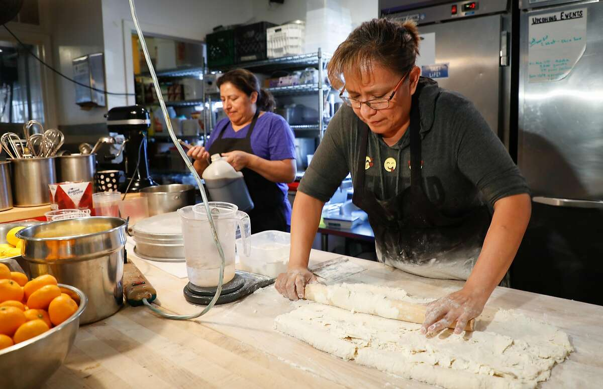 Employee Mary Ortiz rolls out dough for waffle cones at Penny Ice Creamery on Friday, Nov. 30, 2018, in Santa Cruz, Calif. Owner Zachary Davis is a small employer participating in Cal Savers, a state-run retirement program for employers who do not offer their own plan.