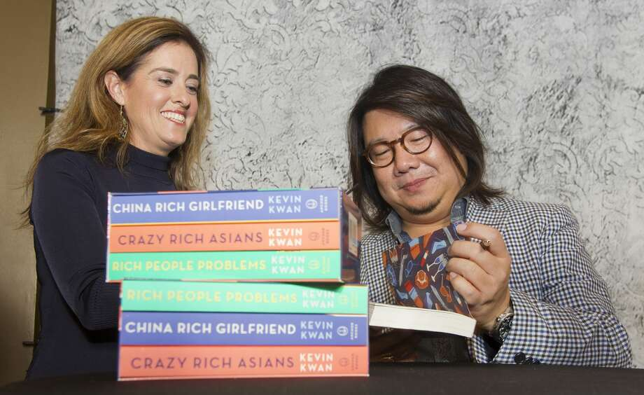 Kevin Kwan, author of the book 'Crazy Rich Asians,' meets with fans and signs books before speaking at The John Cooper School's annual Signature Author Series at The Woodlands Waterway Marriott Hotel and Convention Center, Friday, Nov. 30, 2018, in The Woodlands. Photo: Jason Fochtman/Staff Photographer