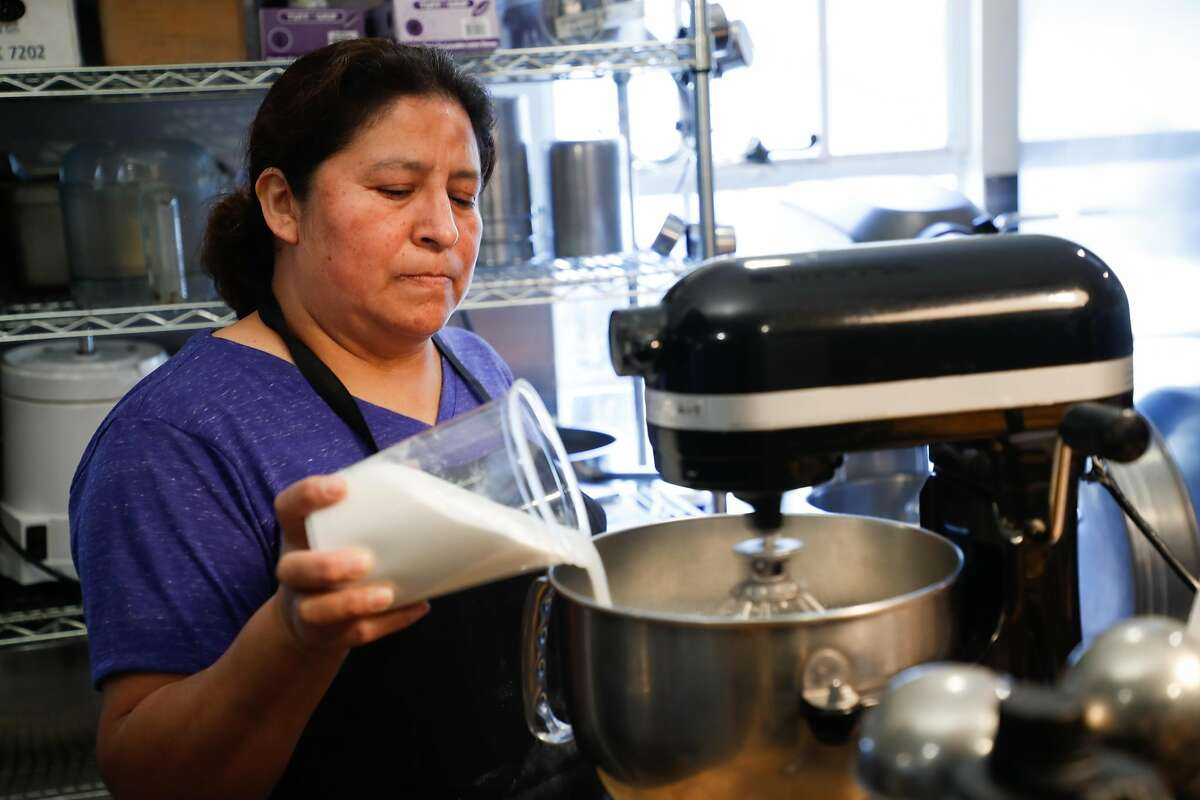 Employee Rocio Perez fills a mixer at Penny Ice Creamery on Friday, Nov. 30, 2018, in Santa Cruz, Calif. Owner Zachary Davis is a small employer participating in Cal Savers, a state-run retirement program for employers who do not offer their own plan.