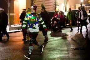 Runners take off from the starting line on Main Street and head down towards the Tridge during the Jingle Bell Run/Walk on Thursday, Nov. 29, 2018. (Katy Kildee/kkildee@mdn.net)