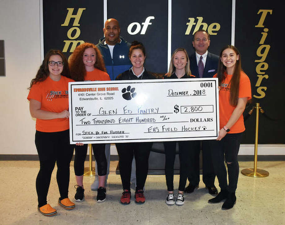 The Edwardsville field hockey program donated $2,800 to the Glen Ed Pantry. The team raised the money through the Stick Up For Hunger campaign with 642 t-shirts sold. Pictured from left to right are Alaina Kaminsky, Kailey Noud, EHS athletic director Alex Fox, EHS coach Jaimee Phegley, EHS freshman coach Annie Nickrent, EHS Principal Dennis Cramsey and Maren McSparin. Photo: Matt Kamp/Intelligencer