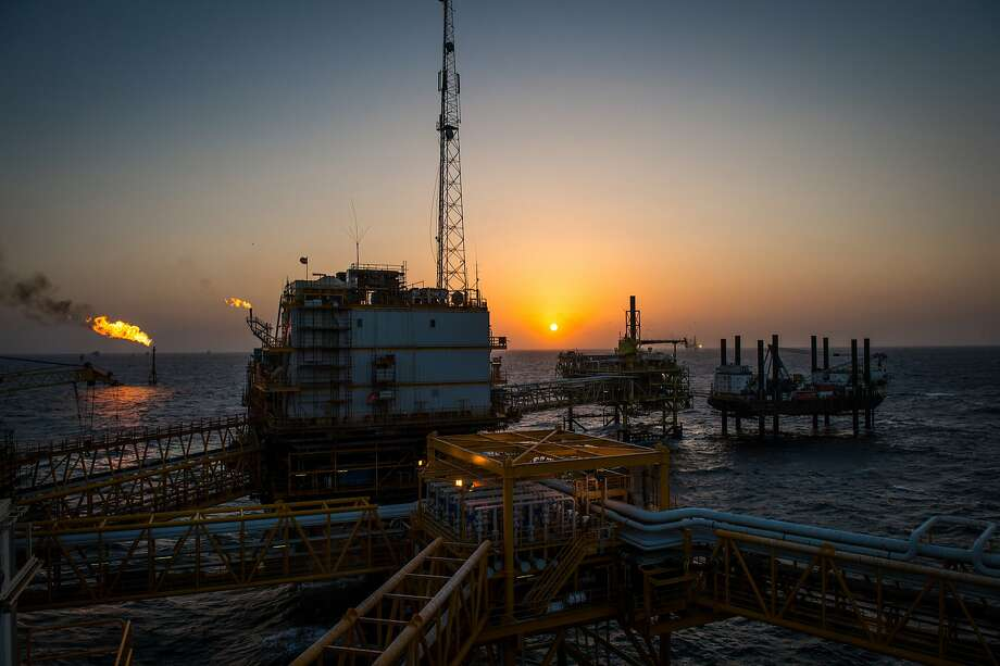 FILE: Gas flares burn from pipes aboard an offshore oil platform in the Persian Gulf's Salman Oil Field, operated by the National Iranian Offshore Oil Co., near Lavan island, Iran, on Thursday, Jan. 5. 2017. Photo: Ali Mohammadi, Bloomberg