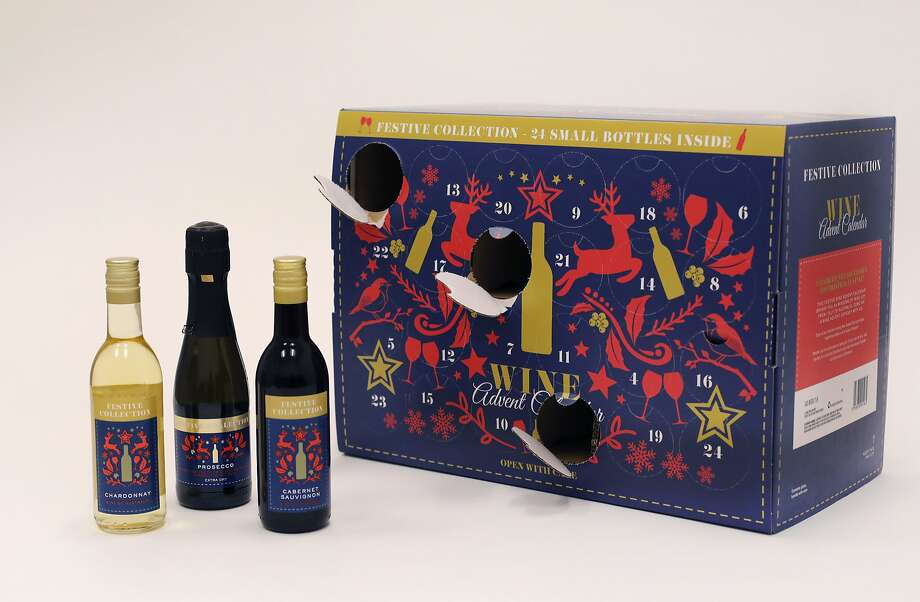 In this Nov. 26, 2018, photo Aldi's Wine Advent Calendar is displayed in New York. The cardboard calendars, typically filled with chocolates, are now being stuffed with cans of beer or bottles of wine. And, making a pairing, others are filled with chunks of cheese. The companies behind them say they appeal to nostalgic adults who want to count the days till Christmas with something other than sweets. (AP Photo/Mark Lennihan) Photo: Mark Lennihan, Associated Press