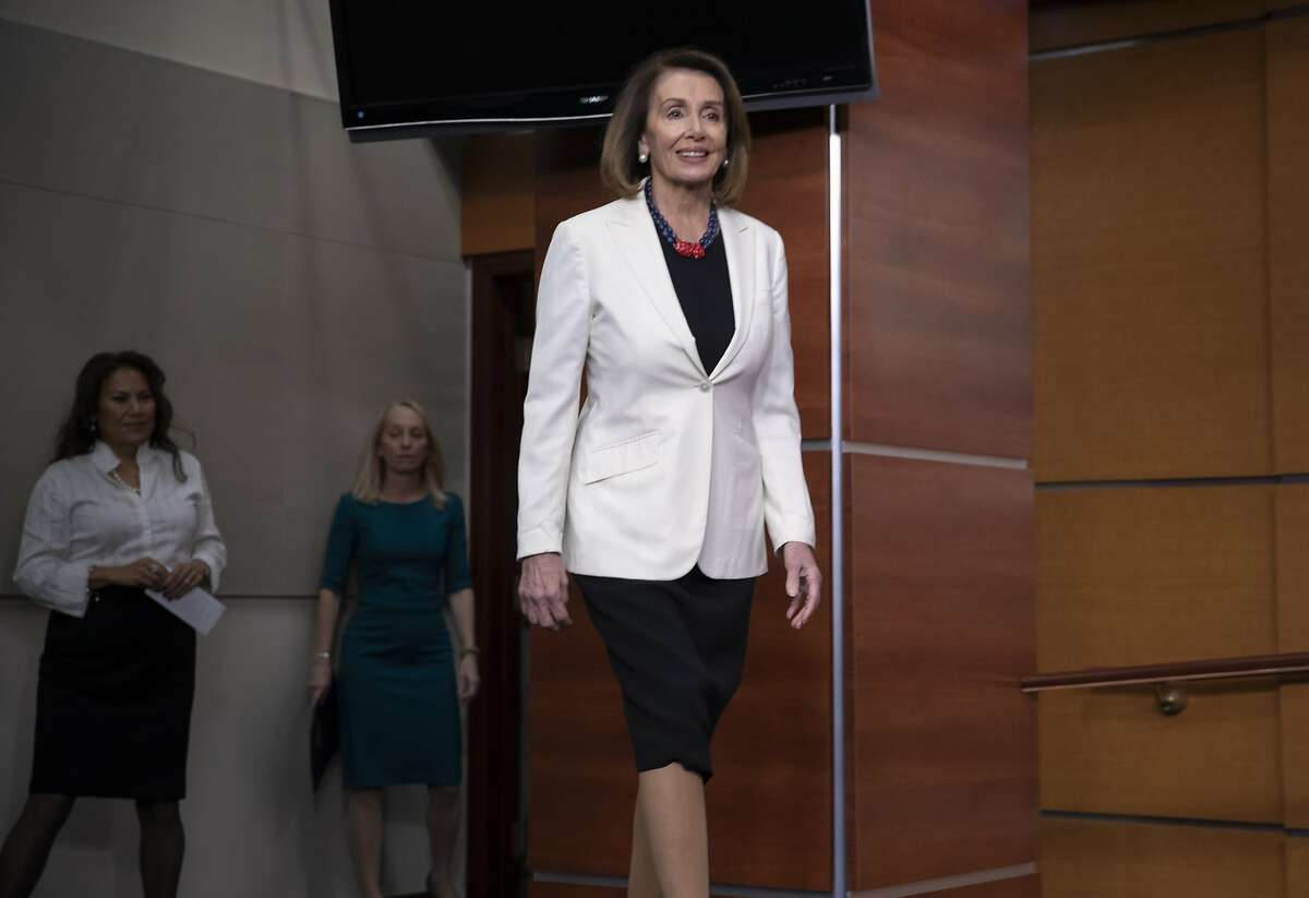 House Minority Leader Nancy Pelosi, D-Calif., arrives at a news conference to discuss her priorities when Democrats assume the majority in the 116th Congress in January, at the Capitol in Washington, Friday, Nov. 30, 2018. (AP Photo/J. Scott Applewhite)