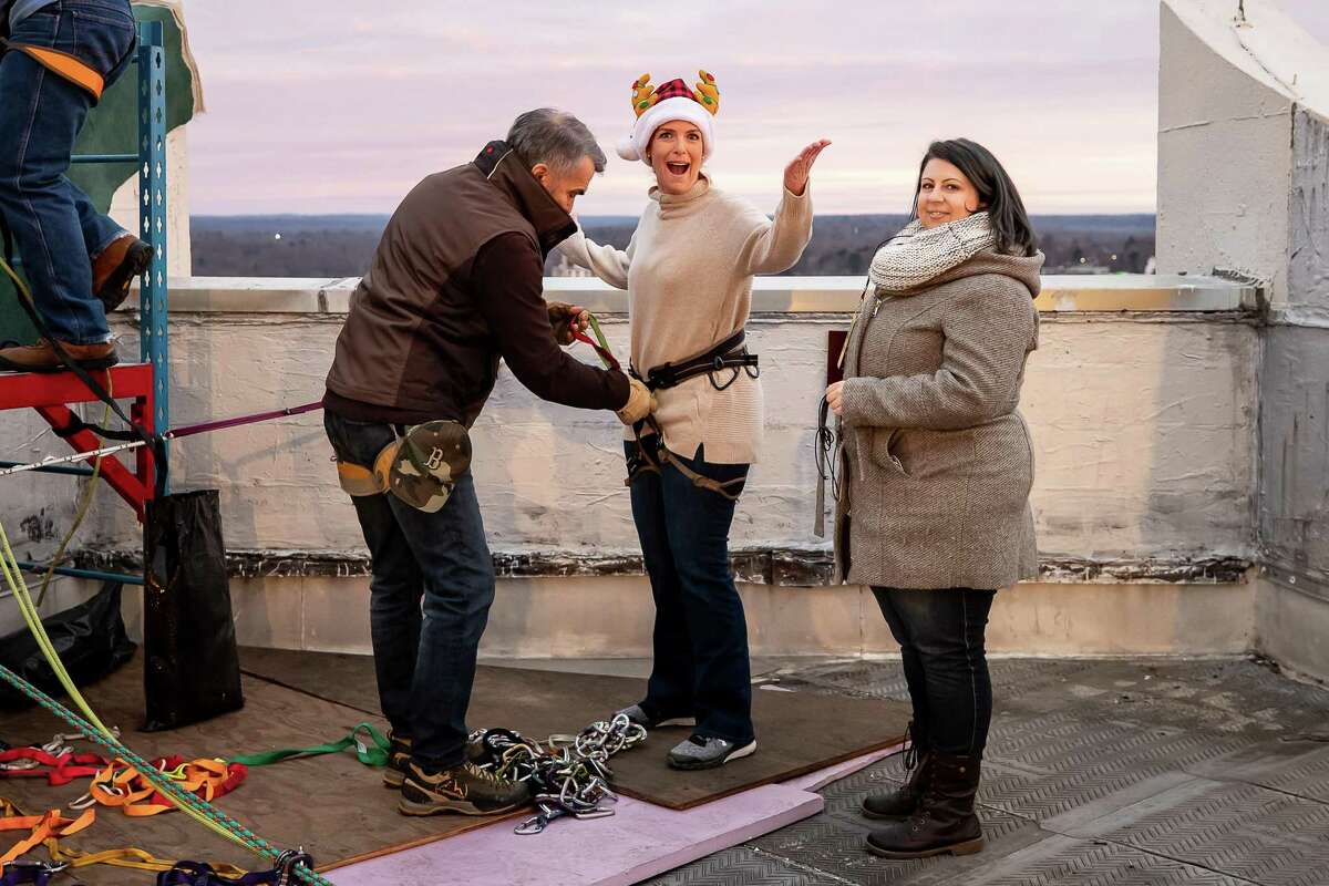 Janice Dean of Fox News is getting her harness secured as she is preparing for her first practice rappel during the Heights and Lights Event rehearsals on November 30,2018 at Landmark Square in Stamford, CT.