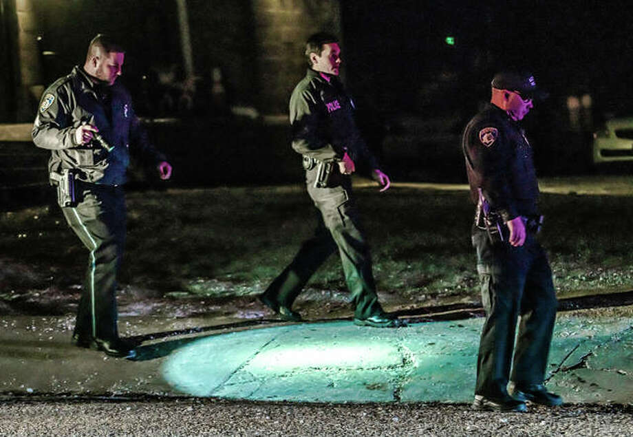 The report of a gunshots and a man hit sent Alton police, fire and rescue to the 800 block of Ridge Street Thursday night. The victim, a white adult male, was conscious and alert when transported to the hospital. His injuries did not appear to be life threatening. Alton police continued to investigate the incident Friday, and anyone with possible information regarding the incident is encouraged to contact the Alton Police Department at 618-463-3505. Photo: Nathan Woodside | The Telegraph