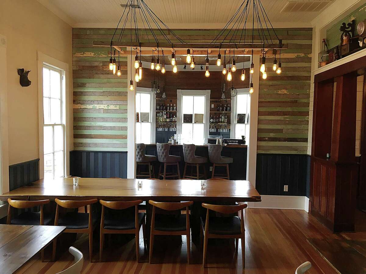 The dining room and chef's table with a view through to the bar at Kindling Texas Kitchen in Cibolo.