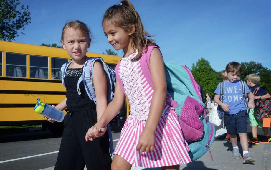 Miller Driscoll students including Olivia Keszkemethy and Lucia Verzelli make their way to their first day of school Tuesday in Wilton. Photo: Erik Trautmann / Hearst Connecticut Media / Norwalk Hour