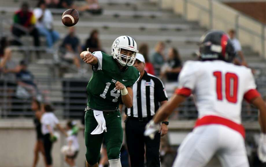 Kingwood Park senior quarterback Sam Johansen (14) targets a receiver against Porter junior defensive back Nathan Grifaldo (10) in the second quarter of their District 9-5A matchup at Turner Stadium in Humble on Sept. 29, 2018. Photo: Jerry Baker, Houston Chronicle / Contributor / Houston Chronicle