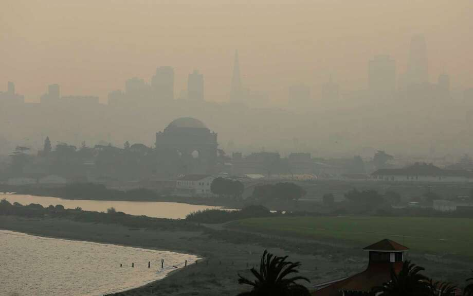 FILE - In this Nov. 19, 2018 file photo, The Palace of Fine Arts and the San Francisco city skyline are obscured due to smoke and haze from wildfires. U.S. Interior Secretary Ryan Zinke says wildfires in California in 2018 released roughly the same amount of carbon emissions as are produced each year to provide electricity to the state. Photo: Eric Risberg, AP / Copyright 2018 The Associated Press. All rights reserved.