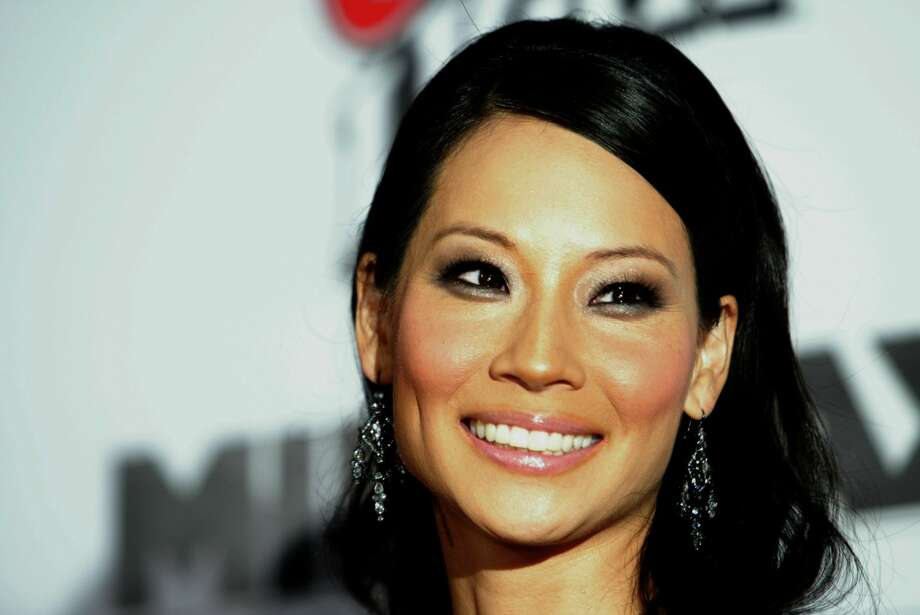 Think you can guess Lucy Liu's age in some of her most iconic photos? Click through this slideshow to find out how accurate you are... Photo: Kevin Winter/Getty Images