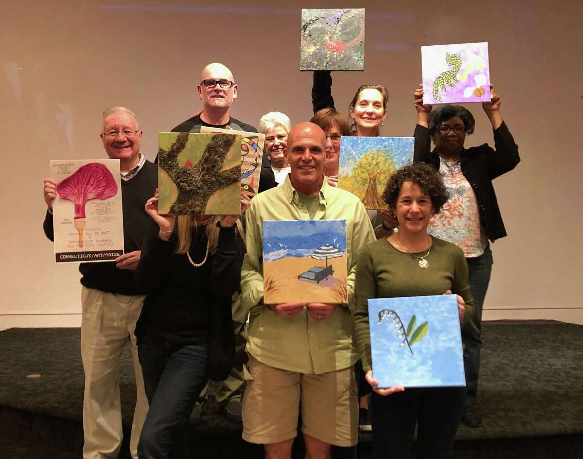 CAFTA announced its painting contest winners. ABove, a group of artists show their work.