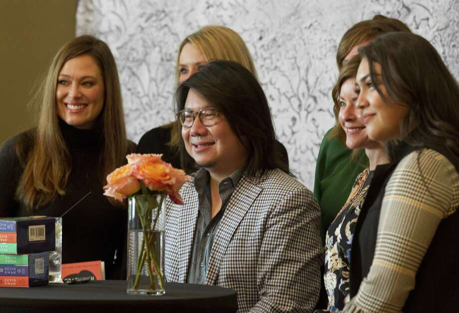 Kevin Kwan, author of the book 'Crazy Rich Asians,' meets with fans and signs books before speaking at The John Cooper School's annual Signature Author Series at The Woodlands Waterway Marriott Hotel and Convention Center, Friday, Nov. 30, 2018, in The Woodlands.>>>Keep clicking to see who turned out for the highly anticipated event.... Photo: Jason Fochtman, Houston Chronicle / Staff Photographer / © 2018 Houston Chronicle