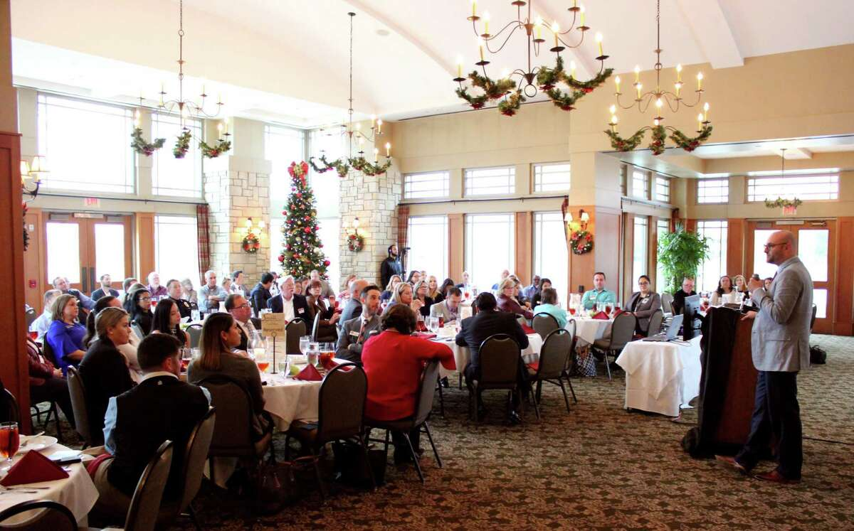 Insperity's Mike Ross speaks at the luncheon Thursday, thanking small-business owners for supporting the community with specialized services and job creation.