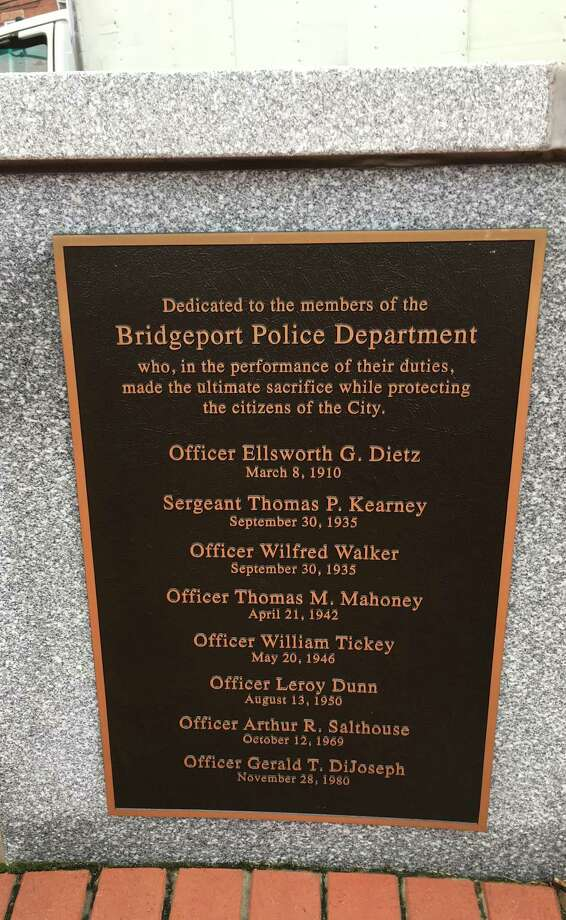 A plaque memorializes the eight Bridgeport officers who died in the line of duty. Photo: Michael J. Daly / For Hearst Connecticut Media