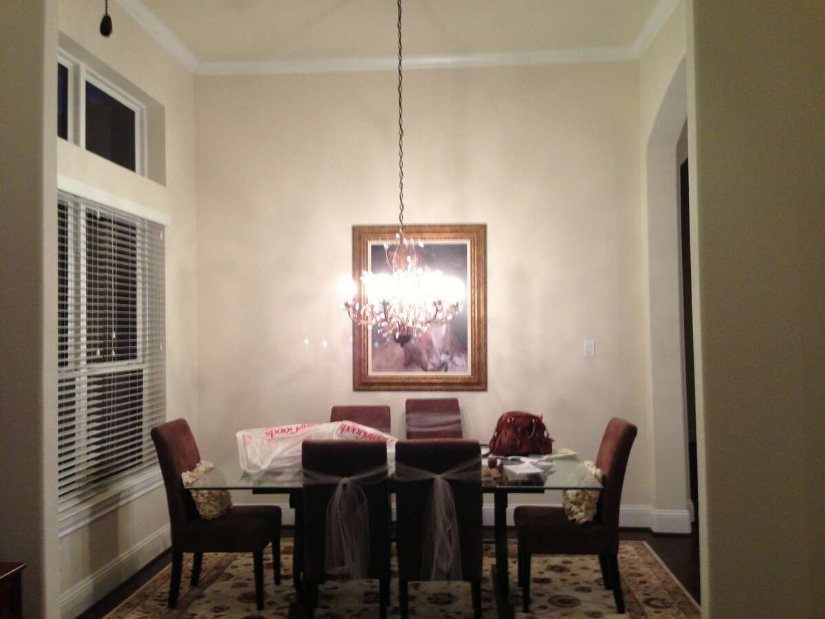 Before, the dining room was plain, with brown chairs around a glass-topped table and a too-small chandelier overhead.