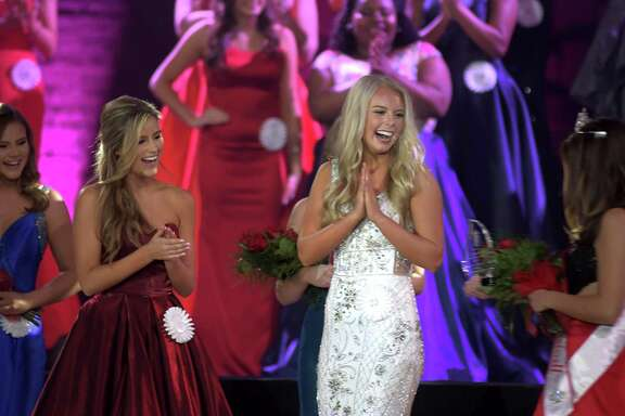 Presley Babb, center, is announced as the new Miss Tomball during the 2019 Miss Tomball Pageant at Salem Lutheran Church in Tomball on Nov. 17, 2018. Ava Hernandez, left, was the first runner-up for the crown.