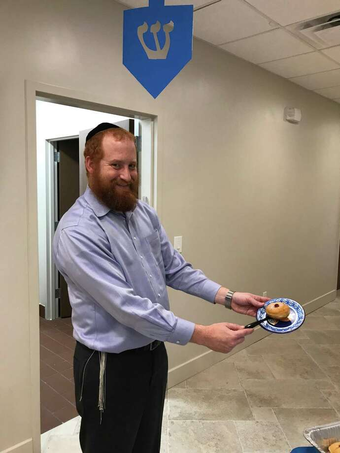 Goldstein and Elisa, co-directors at Chabad West Houston, will be celebrating their first Hanukkah in their new temple on 12645 Whittington Drive in Houston. Photo: Michelle Iracheta / Michelle Iracheta