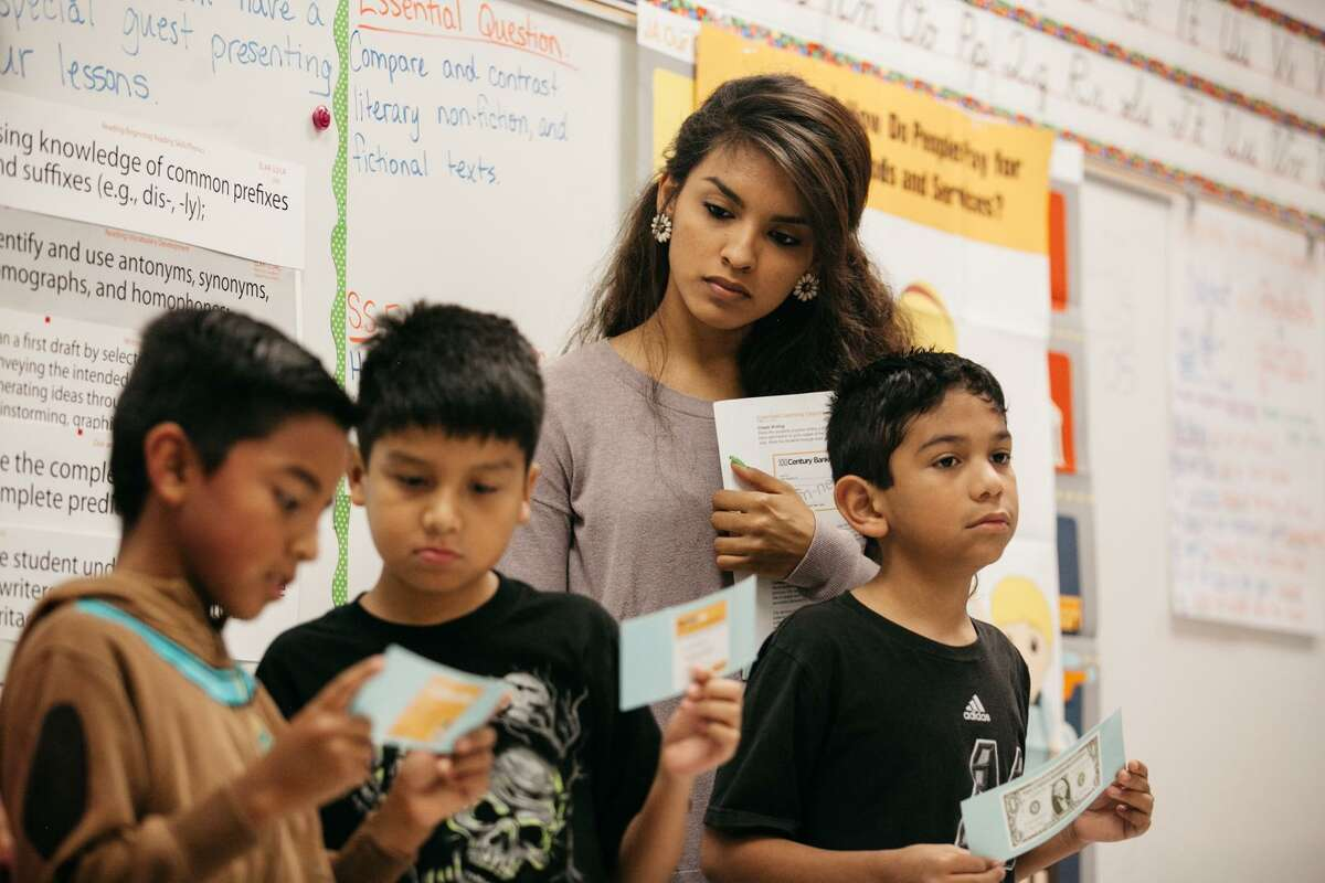Palo Alto College freshman Abigail Macias teaches during a Junior Achievement lesson plan on finances Friday Oct. 28, 2016 during the weekly student teaching by Palo Alto College students at Bellaire Elementary School.