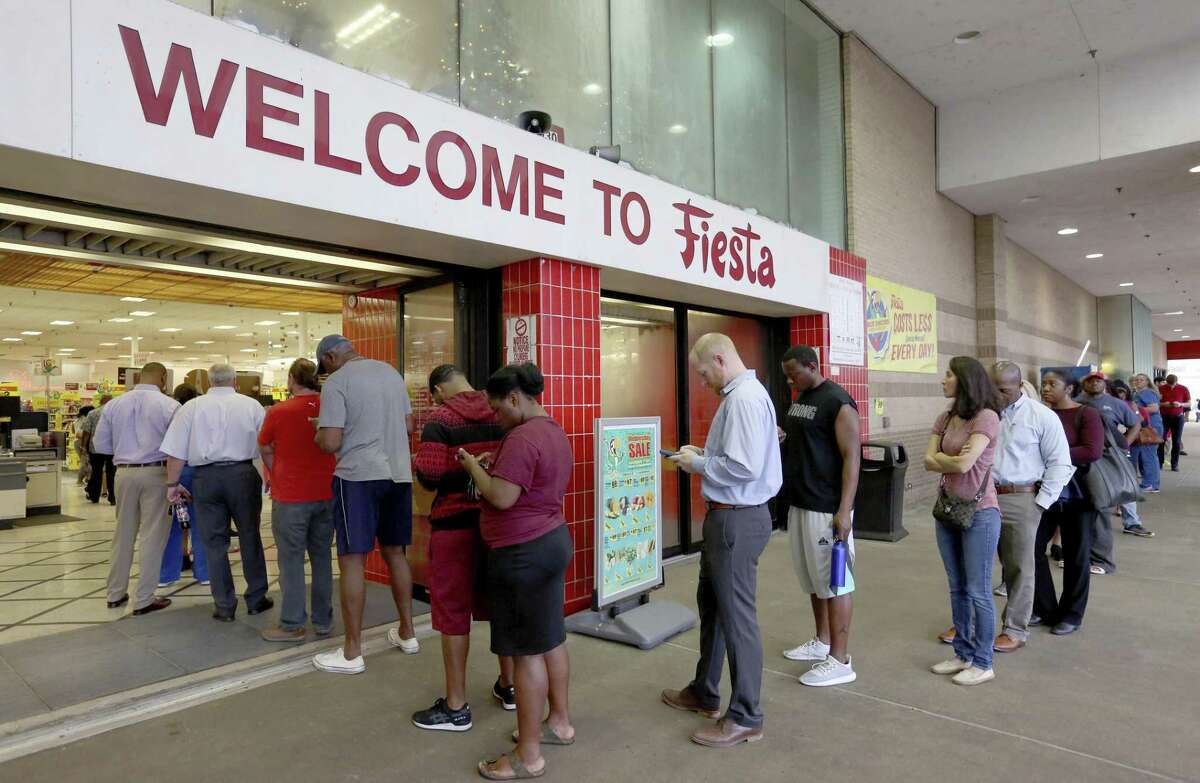 Voters line up outside of Fiesta Mart to vote on Election Day in Houston. It's time for a a new option on the ballot.