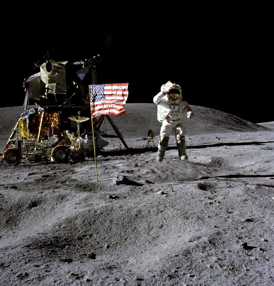 In this April 1972 photo made available by NASA, John Young salutes the U.S. flag at the Descartes landing site on the moon during the first Apollo 16 extravehicular activity. America's next moon landing will be made by private companies, not NASA. NASA Administrator Jim Bridenstine announced Nov. 29 that nine U.S. companies will compete in delivering experiments to the lunar surface. Photo: Charles M. Duke Jr. /Associated Press / NASA