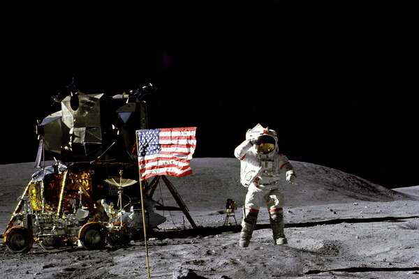 In this April 1972 photo made available by NASA, John Young salutes the U.S. flag at the Descartes landing site on the moon during the first Apollo 16 extravehicular activity. America's next moon landing will be made by private companies, not NASA. NASA Administrator Jim Bridenstine announced Nov. 29 that nine U.S. companies will compete in delivering experiments to the lunar surface.