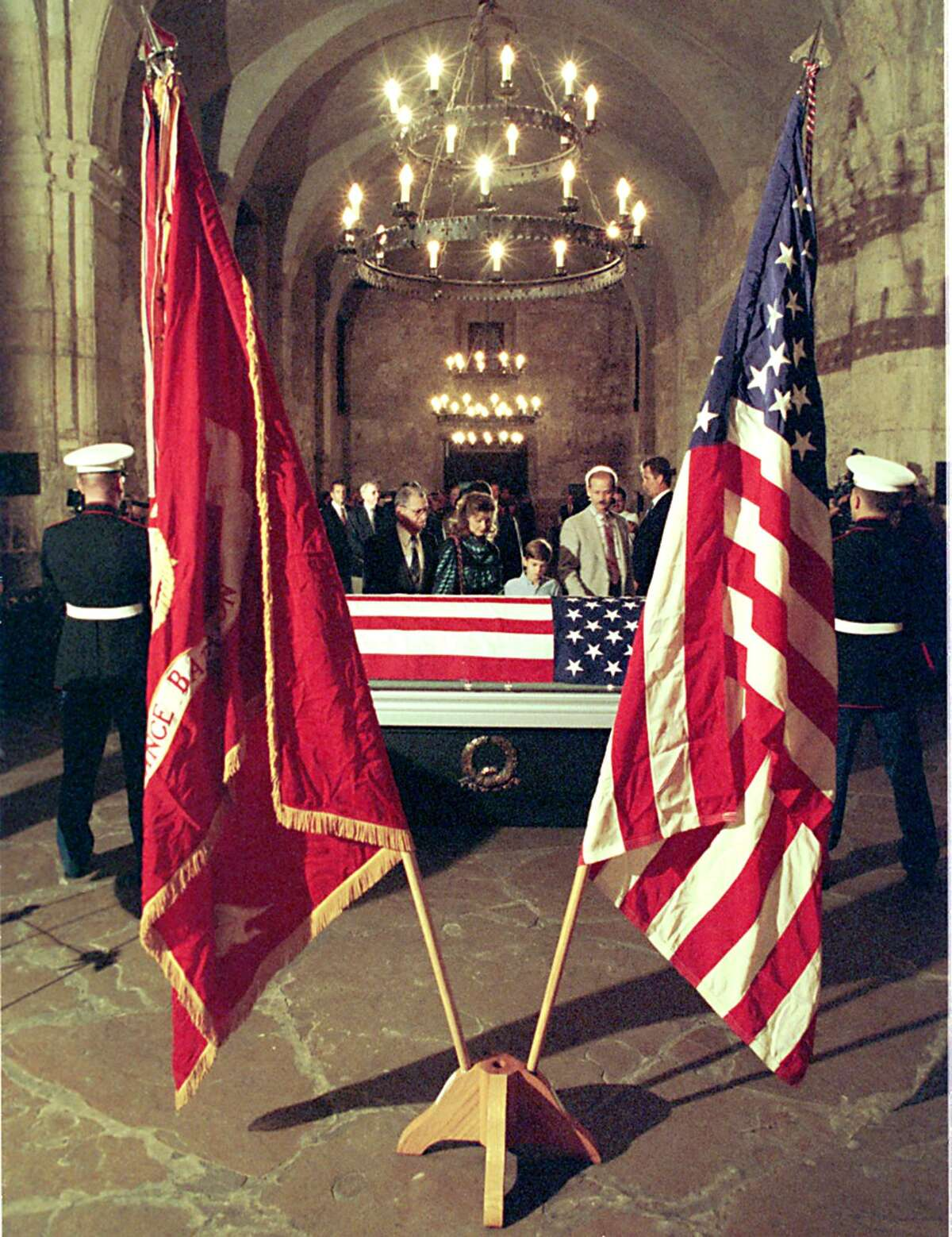 Family members file past the flag-draped caket containing the body of Marine Staff Sgt. and World War II Medal of Honor recipient William J Bordelson as it lay in state in the Alamo chapel.