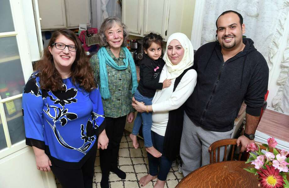 Aminah, center right, with her daughter, Retaj, 4, and husband, Issa, right, are photographed in the kitchen of their home in New Haven with Jean Silk, center left, coordinator of Jewish Community Alliance for Refugee Resettlement, and Gilah Benson-Tilsen, left, JCARR team leader Congregation Beth El-Keser Israel, on Nov. 28. Photo: Arnold Gold / Hearst Connecticut Media / New Haven Register
