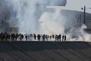 View of tear gas that border police used to prevent groups of people from crossing the US-Mexico border at El Chaparral on Nov. 25 in Tijuana, Mexico. The incident proves the media wrong about the caravan.