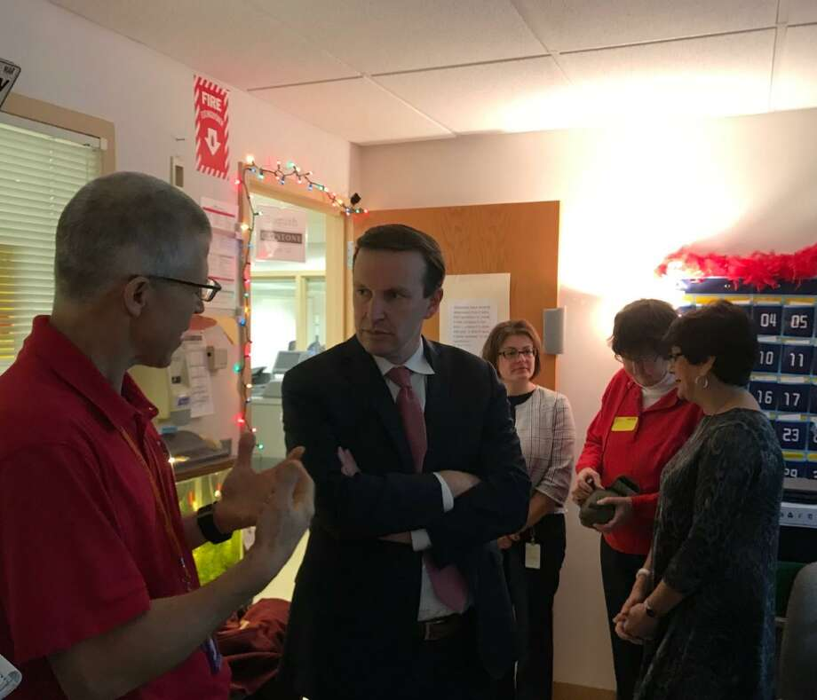 Paul Bogush, a seventh-grade teacher at Dag Hammarskjöld Middle School in Wallingford, explains to U.S. Sen. Chris Murphy what his class is working on Friday. Photo: Luther Turmelle / Hearst Connecticut Media