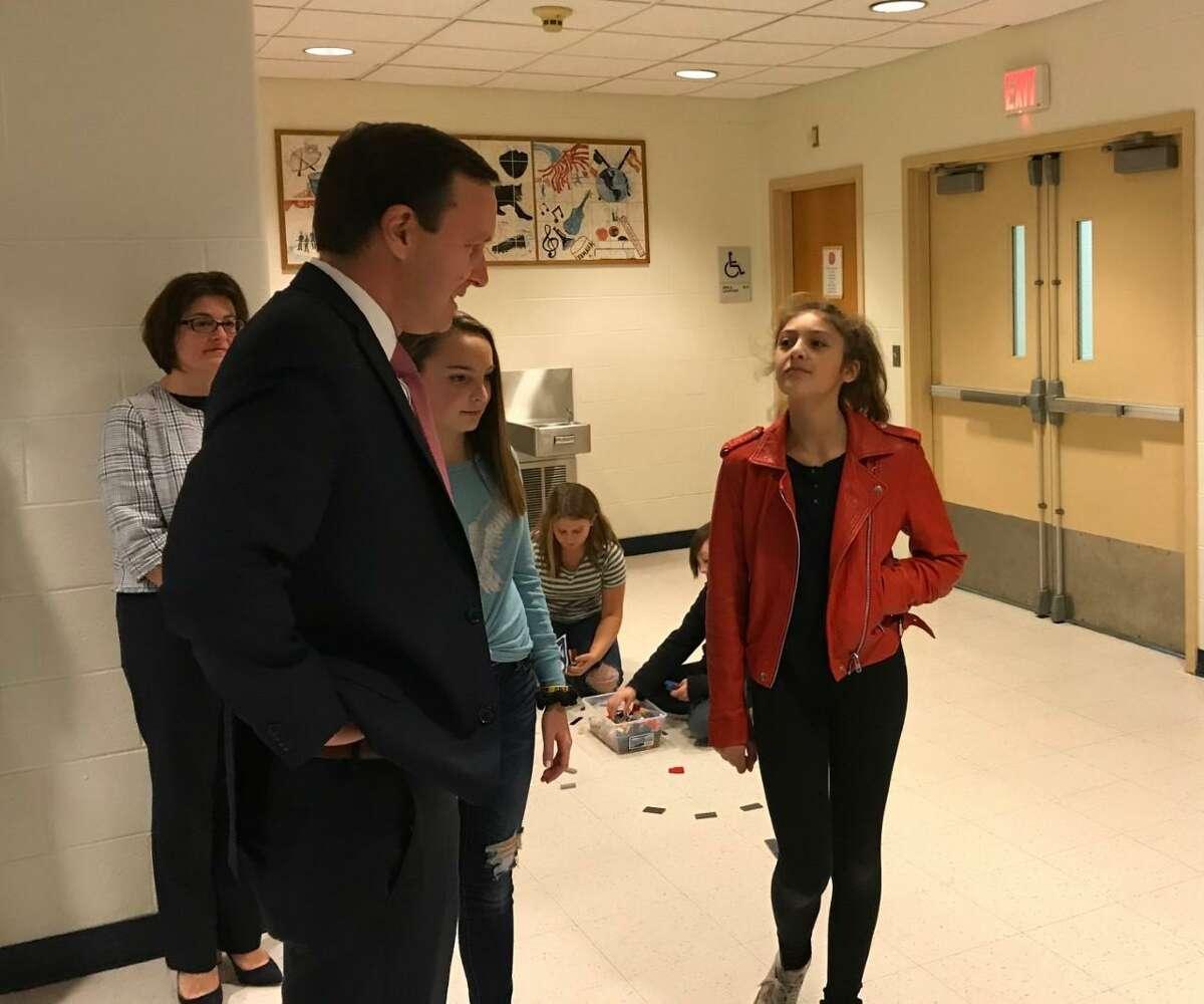 U.S. Sen. Chris Murphy talks with students at Dag Hammarskjöld Middle School in Wallingford Friday.