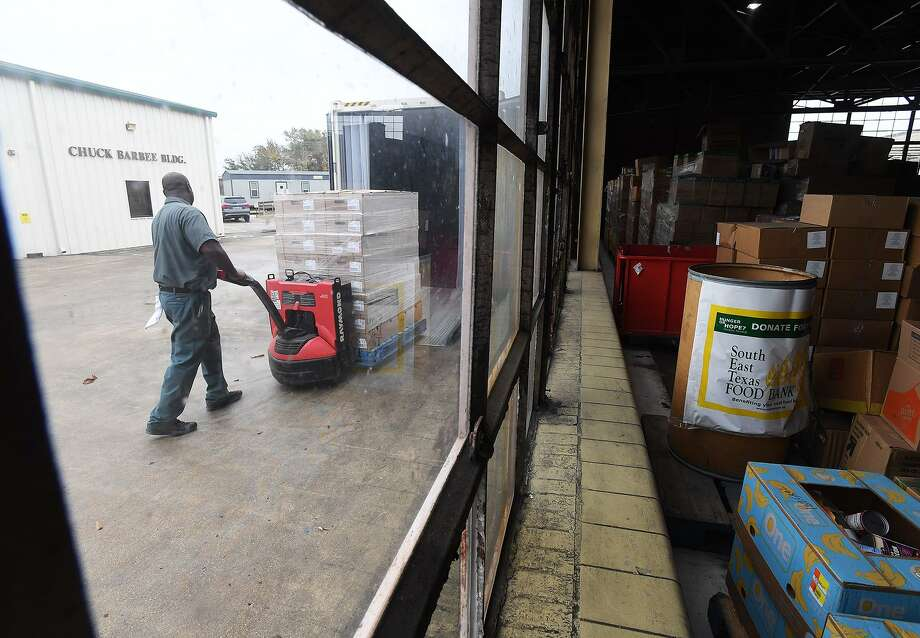 Leonard Faulk hauls part of 14,000 pounds of ham and turkey donated to the Southeast Texas Food Bank by H-E-B on Friday. The gift was sent to provide protein, an uncommonly donated item, in time for Christmas.  Photo taken Friday, 11/30/18 Photo: Guiseppe Barranco/The Enterprise, Photo Editor / Guiseppe Barranco ©