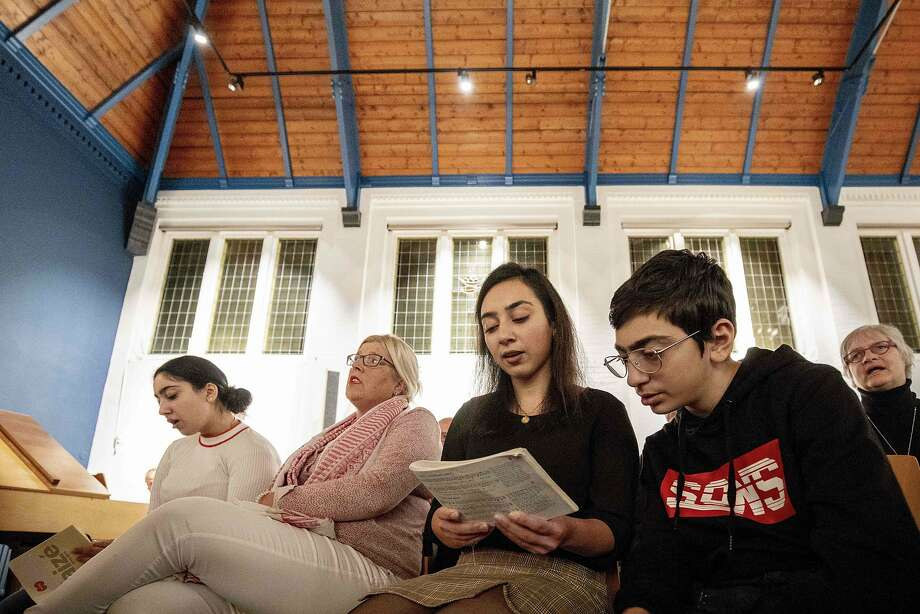 Seyran (right) and his sister Warduhi were born in Armenia. The family has taken shelter in the Bethel church in The Hague, which is holding non-stop services to prevent deportation. Photo: Niels Wenstedt / AFP / Getty Images