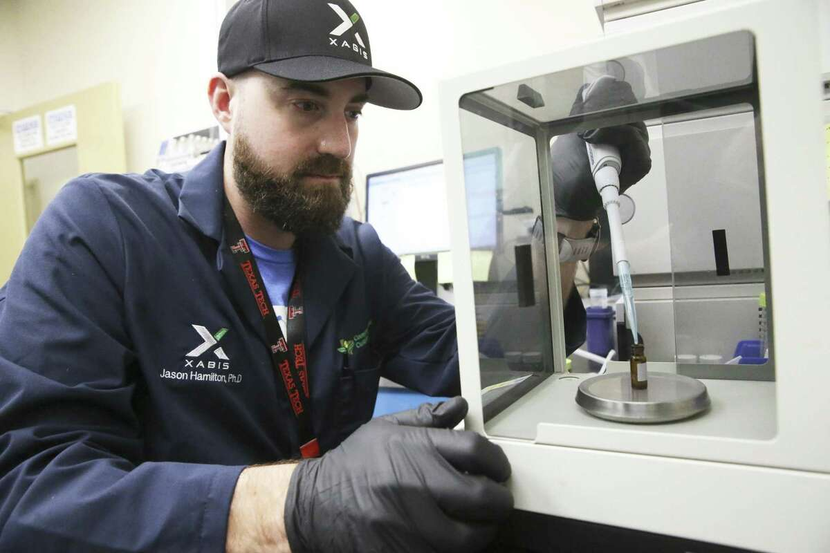 A sample is prepared for potency testing by Quality Control specialist Jason Hamilton, PhD., as employees work at Compassionate Cultivation on November 29, 2018.