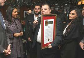 Mayor London Breed (left) with owner John Konstin and his son and daughter as he receives a certificate from Senator Scott Weiner as John's Grill celebrates its 110th anniversary  on Thursday, Nov. 29, 2018, in San Francisco, Calif.