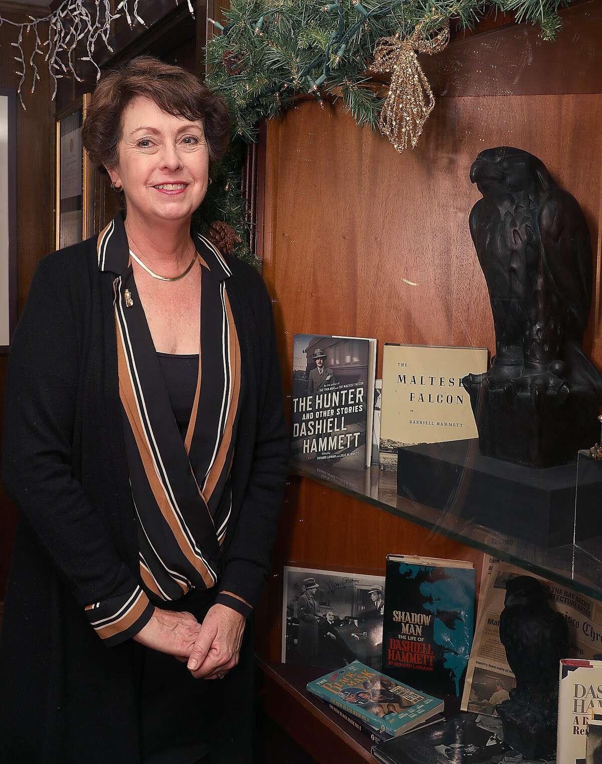 Julie Rivett, granddaughter of author Dashell Hammett shows the Maltese Falcon at John's Grill made famous by Hammett's detective novel as John's Grill celebrates its 110th anniversary on Thursday, Nov. 29, 2018, in San Francisco, Calif.