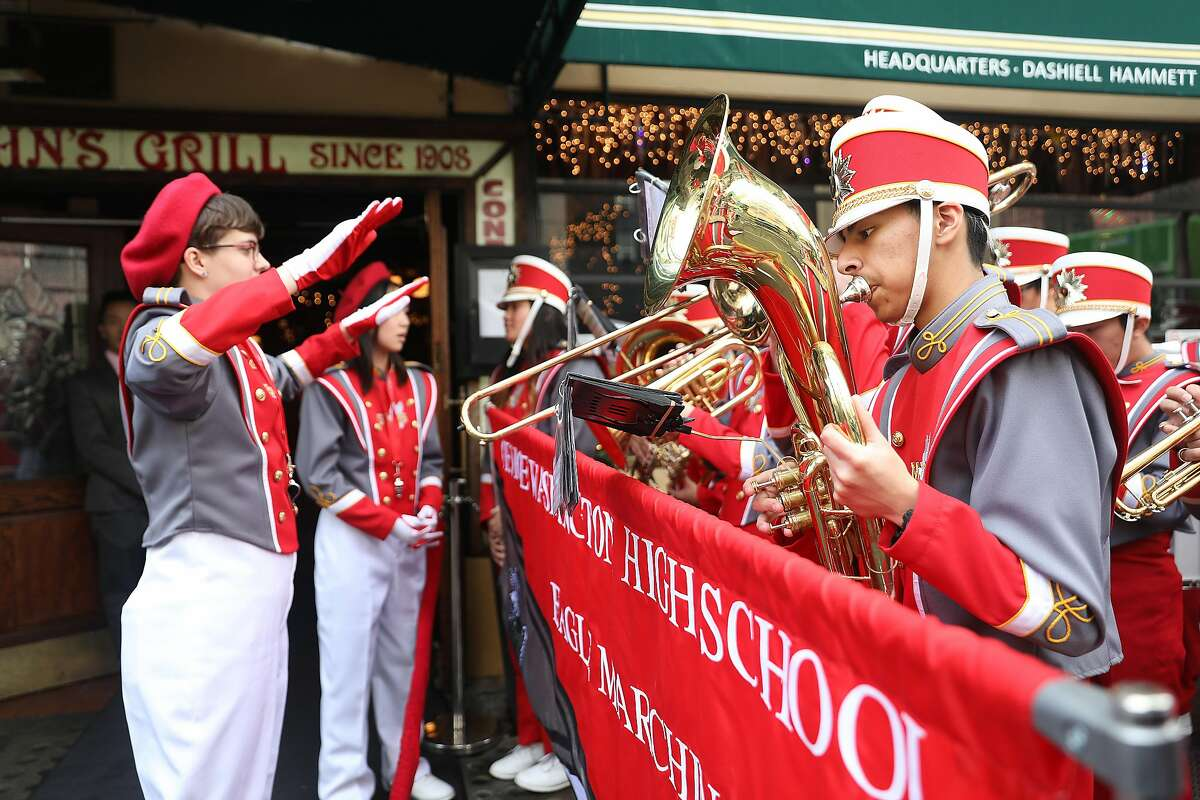 The George Washington High School marching band performs in front of John's Grill as it celebrates its 110th anniversary on Thursday, Nov. 29, 2018, in San Francisco, Calif.